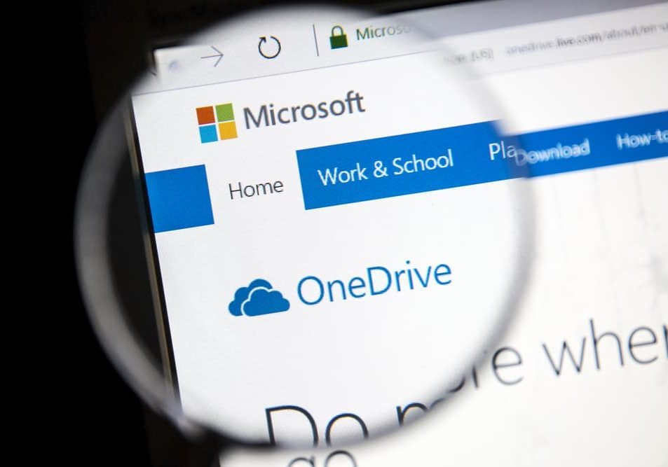 microsoft onedrive website under a magnifying glass